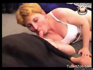 Short-haired MILF is sucking doggy's dick with passion