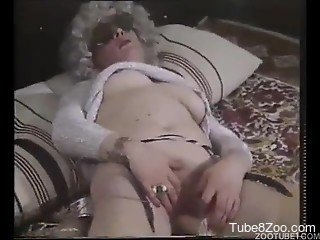 Vintage animality XXX in the bed with two busty babes and a dog