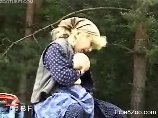 Mature lady with big boobs fucks with black stallion in the fo...