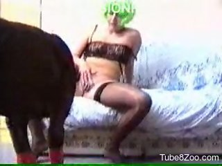 Green-haired slut and big black dog fuck in doggy style pose