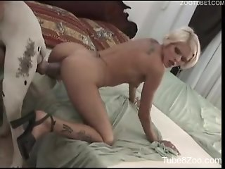 Skinny young blonde swallows dog semen after filthy zoophile sex