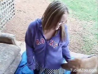 Girl in violet sweatshirt bares pussy to be drilled by dog