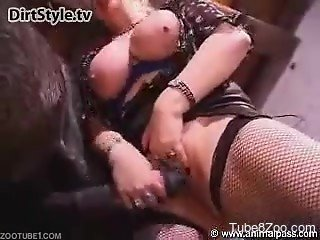 Fishnets-wearing blonde sucking a huge stallion cock