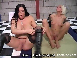Two lovely girls getting fucked by a dog together