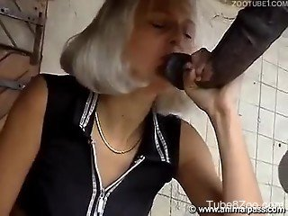 Blonde in a wig takes a horse's huge cock on cam