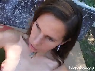 Brunette Latina spreads her legs to get fucked by a dog