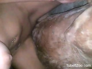 Dark-haired gal riding a stiff penis on camera